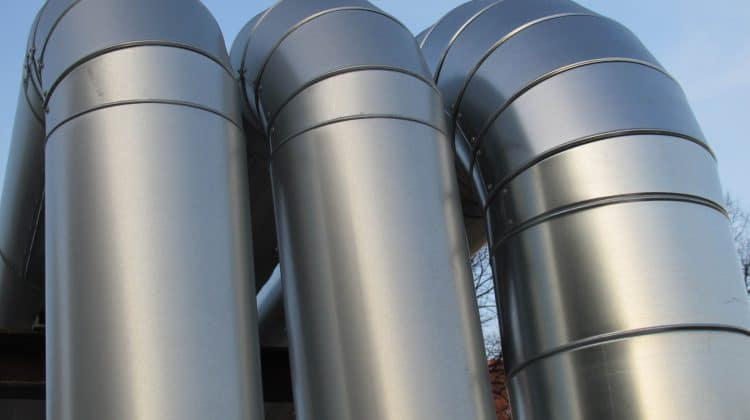 Large metal tubes commonly found on geothermal power plants.