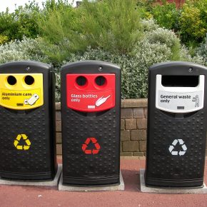 Three recycling bins used for different materials.