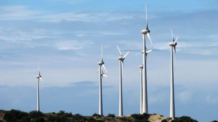 A collection of wind turbines making an impact on the environment.