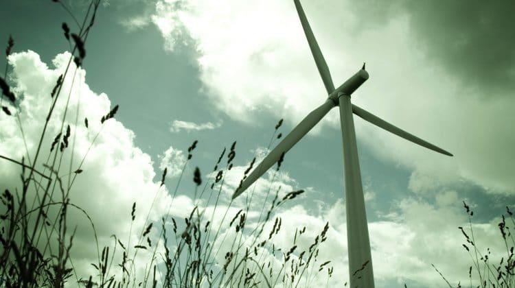 A wind turbine harnessing wind energy.