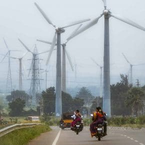 Wind turbines installed next to a highway in Tamil Nadu, India.