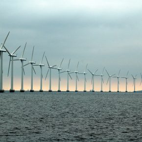 A collection of wind turbines at sea.