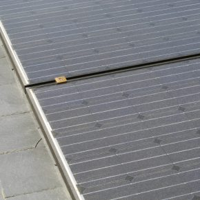 Solar roof tiles blending in with existing roof slates.