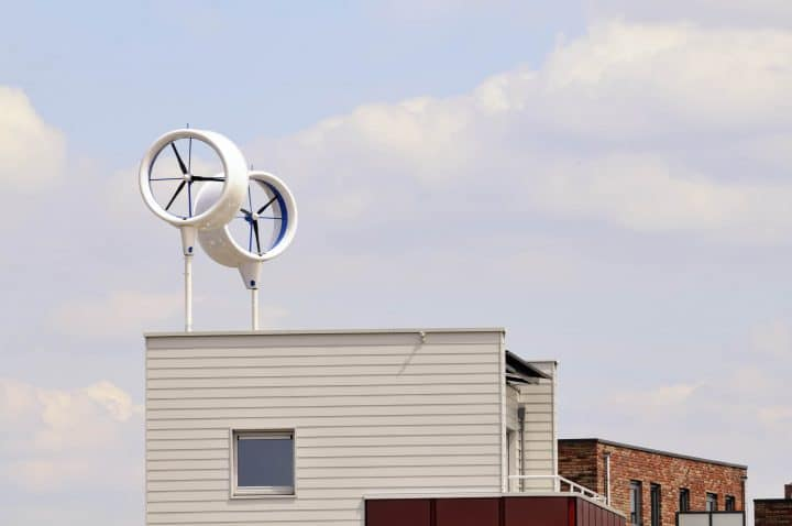 Two wind turbines fitted to the roof of a house.