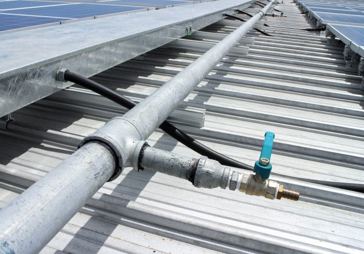 A water supply installed as part of a solar panel installation.