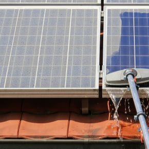 Somebody cleaning solar panels.