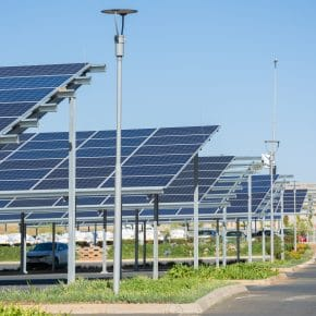 A solar panel canopy over a car park.