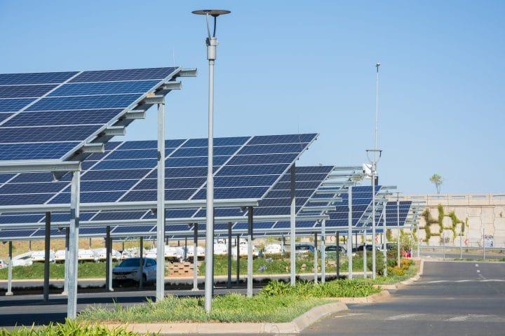 A solar panel canopy over a car park.